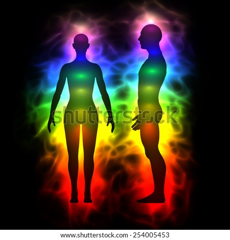 Aura, healing energy, extrasensory perception - woman and man silhouette - stock photo