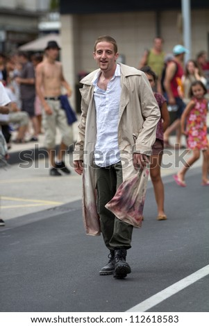 AURILLAC, FRANCE - AUGUST 23: an unidentified actor announces his show in the street as part of the Aurillac International Street Theater Festival, on august 23, 2012, in Aurillac,France. - stock photo