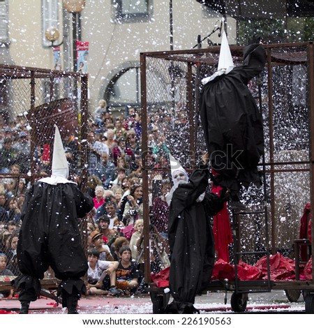 AURILLAC, FRANCE-AUGUST 22: disguised people move under the snow as part of the Aurillac International Street Theater Festival, cie teatro del silencio there august 22, 2014 in Aurillac, France. - stock photo