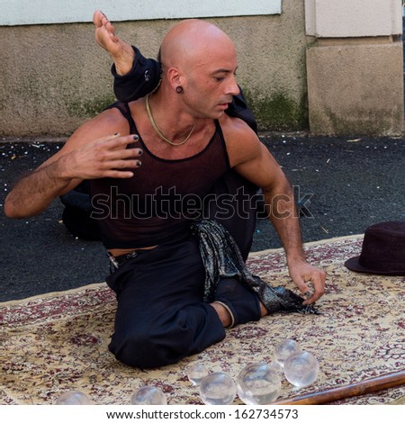 AURILLAC, FRANCE - AUGUST 23: Portrait of a very supple street performer, named Jyoti, as part of the Aurillac International Street Theater Festival, on august 23, 2013, in Aurillac,France  - stock photo