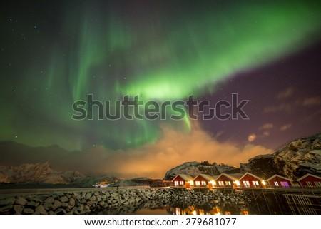 Aurora borealis in Mortsund harbour, near small town Leknes, Lofoten islands, Norway - stock photo