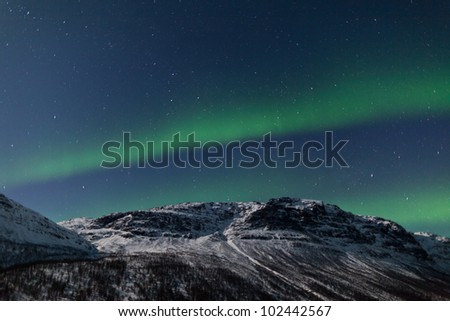 Aurora Borealis in Norway over mountains - stock photo
