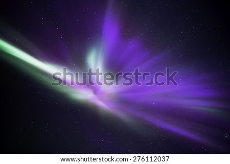 Auroras in Iceland forming an angelic shape in the nightsky - stock photo