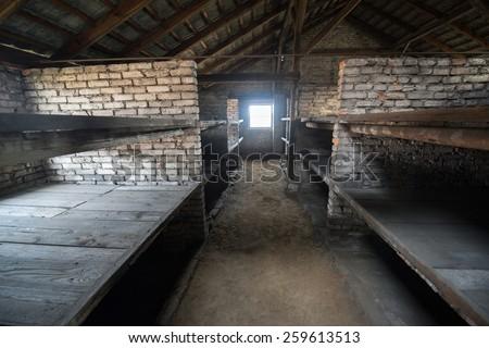 Auschwitz Birkenau a former Nazi extermination camp in Brzezinka, Poland near Oswiecim. Horrible beds of prisoners in one of the buildings. - stock photo