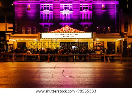 AUSTIN - MARCH 26: People gather for a red carpet gathering under a SXSW marquee at the Paramount Theater on March 26, 2012 in Austin, Texas. - stock photo