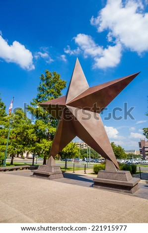 AUSTIN -SEPTEMBER 27 : Big star decorated in the city against blue sky on September 27, 2014 in Austin,Texas. Austin, capital city of Texas state settled in 1835, is the 11th most populous city in US. - stock photo