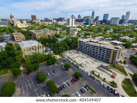 Austin Texas Aerial Shot Over House Skatepark near ACC Campus and the Texas State Capitol Building stands high on a hilltop with the Skyline Cityscape of the Austin Downtown area  - stock photo