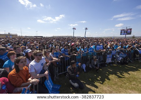 AUSTIN, TEXAS - FEBRUARY 27, 2016: A crowd of people listen to Bernie Sanders speak during a campaign rally at the Circuit of the Americas. - stock photo