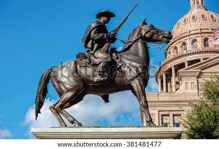 AUSTIN, TEXAS - February 1, 2012: The statue of Terry's Texas Ranger with the Texas state capitol building and US flag in background - stock photo