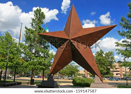 AUSTIN,TEXAS-JUL 19: Artificial star decorated in city at blue sky on July 19, 2008 in Austin, Texas, USA. Austin, capital city of Texas state settled in 1835, is the 11th most populous city in US. - stock photo