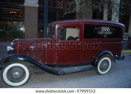 AUSTIN, TEXAS - MAR 9: SXSW 2012 on March 9, 2012 in Austin, Texas. Landmark delivery wagon at the Driskill used to be 1886 Cafe & Bakery on old Pecan Street now 6th street. - stock photo