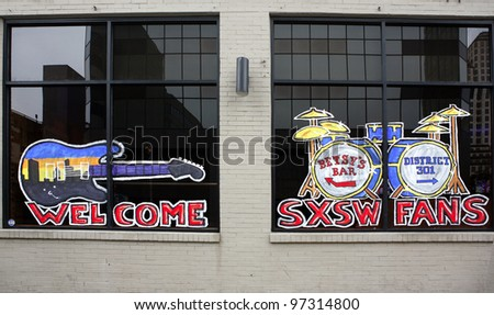 AUSTIN, TEXAS - MAR 9: SXSW 2012  South by Southwest 2012 Annual music, film, and interactive conference and festival on March 9, 2012 in Austin, Texas. Festival is held from March 9-18. Painting on window, 6 Street - stock photo