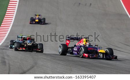 AUSTIN, TEXAS - NOVEMBER 17. Sebastian Vettel of Red Bull Racing, leading Romain Grosjean of Team Lotus during the start of  Formula 1 United States Grand Prix on November 17, 2013 in Austin, Texas. - stock photo