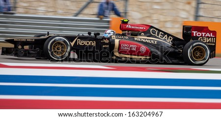 AUSTIN, TEXAS � NOVEMBER 16.  Team Lotus races in the Formula One Qualifying Session at the Circuit of the America's race track on November 16, 2013 in Austin, Texas. - stock photo