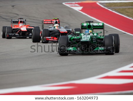 AUSTIN, TEXAS � NOVEMBER 16.  Three Formula 1 cars entering Turn 13 in the Formula One Qualifying Session at the Circuit of the America's race track on November 16, 2013 in Austin, Texas. - stock photo