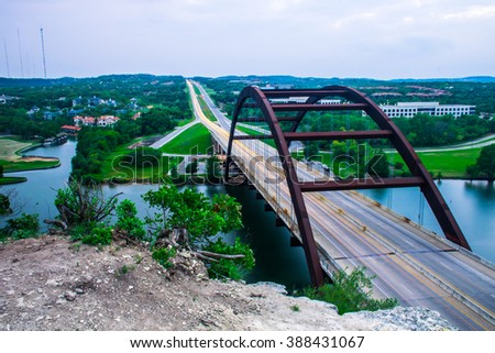 Austin Texas traffic Suspension Bridge Landmark 360 Bridge or Penny backer Bridge built in 1984 this amazing rusty bridge spans across the colorado river  - stock photo
