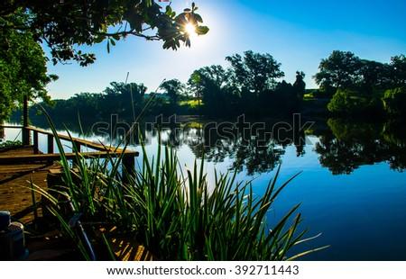 Austin texas travis lake LBJ reflections mirror image on the water during sunrise  - stock photo