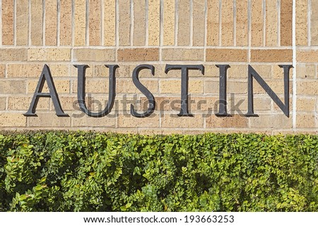 Austin Text Sign Mounted on a Brick Wall - stock photo