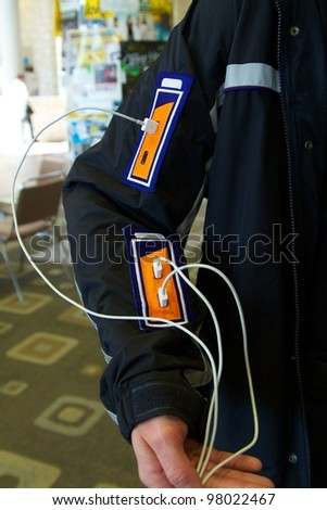 AUSTIN, TX - MAR 12: SXSWi 2012. SXSW Interactive Conference on March 12, 2012 in Austin, Texas. Special jacket with USB ports delivers power to conference attendees. - stock photo