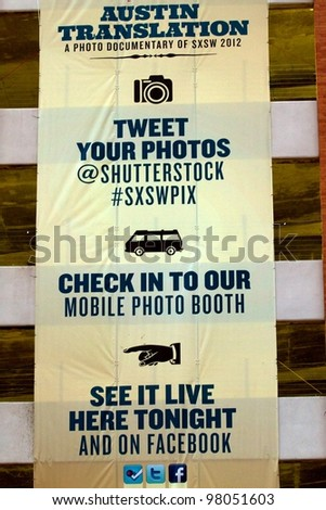 AUSTIN, TX - MAR 9: SXSWi 2012. SXSW Interactive Conference on March 9, 2012 in Austin, Texas.  ShutterStock Poster on 5th and Colorado. - stock photo