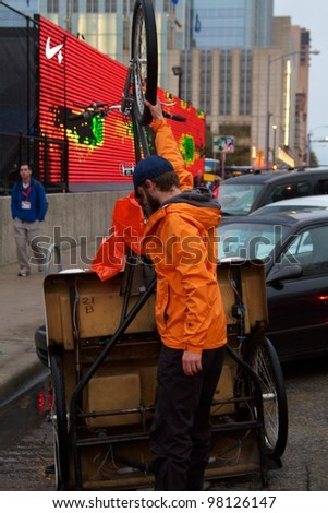 Austin, TX - March 10: SXSW Interactive Conference in Austin.   Austin Pedicabs are in high demand during the conference - stock photo