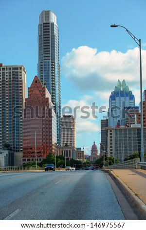 AUSTIN,TX/USA - JULY 9 Downtown Austin, Texas showing the State Capitol building at the end of the street on July 09, 2013. Austin is experiencing a population explosion since the 2008 crash. - stock photo