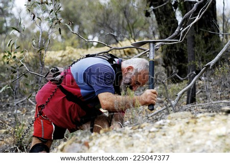 AUSTRALIA - APRIL 24: The hollow gold miner with his pick of where the detector indicated the possible presence of a nugget of gold in the ground, april 24, 2007. - stock photo