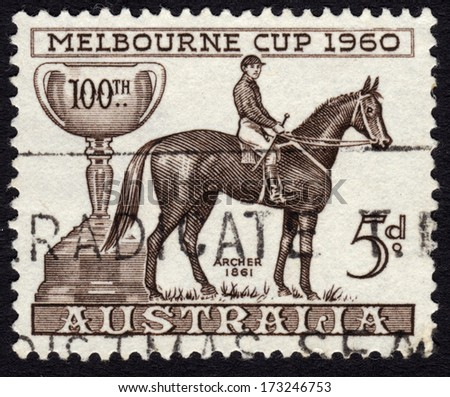 AUSTRALIA - CA. 1960: Australian postage stamp ca. 1960 commemorating the 100th edition of the Melbourne Cup horse race - stock photo