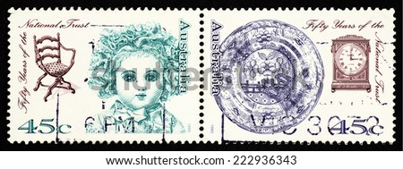 AUSTRALIA - CIRCA 1995: A pair of postage stamp printed in Australia with image of antique doors, furniture, cutlery wares and clock to commemorate the fifty years of the Australian National Trust. - stock photo