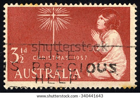 AUSTRALIA - CIRCA 1957: A stamp printed by Australia shows The Spirit of Christmas (after Sir Joshua Reynolds), Christmas series, circa 1957.  - stock photo