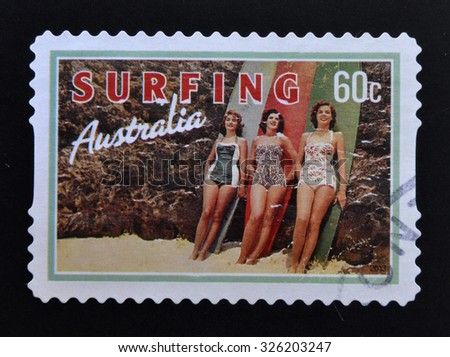 AUSTRALIA - CIRCA 2013: A stamp printed in Australia dedicated to Surfing, shows Beach Beauties, circa 2013 - stock photo