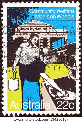 """AUSTRALIA - CIRCA 1980: A stamp printed in Australia from the """"Community Welfare"""" issue shows meals on wheels, circa 1980. - stock photo"""