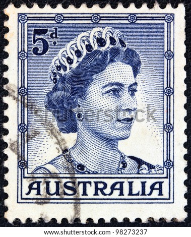 AUSTRALIA - CIRCA 1959: A stamp printed in Australia shows a portrait of Queen Elizabeth II, circa 1959. - stock photo