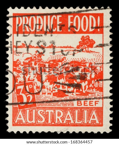 AUSTRALIA - CIRCA 1959: A stamp printed in Australia shows herd of cows, circa - stock photo