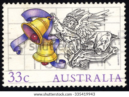 AUSTRALIA - CIRCA 1985: A stamp printed in Australia shows Illustrations by Scott Hartshorne, Angel with bells, Christmas Issue, circa 1985 - stock photo