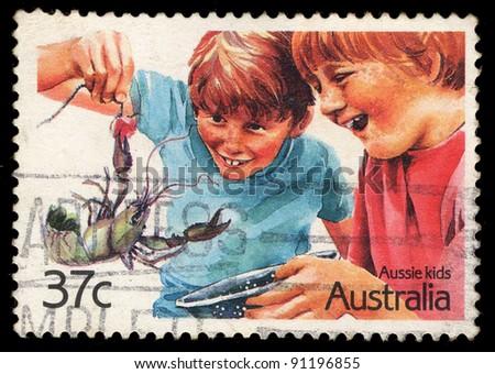 AUSTRALIA - CIRCA 2002: A stamp printed in Australia shows image of Aussie kids, series, circa 2002 - stock photo