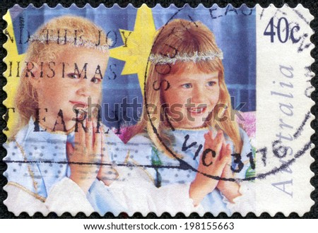 "AUSTRALIA - CIRCA 1997: A Stamp printed in AUSTRALIA shows the Children in Christmas Nativity pageant, ""Angels"", Christmas series, circa 1997 - stock photo"