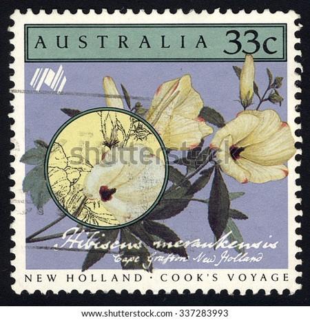 AUSTRALIA - CIRCA 1986: A stamp printed in the Australia shows Hibiscus meraukensis, New Holland - Cook Voyage, 200 years of colonization of Australia series, circa 1986 - stock photo