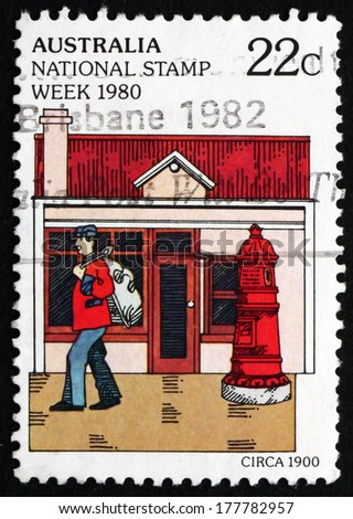 AUSTRALIA - CIRCA 1980: a stamp printed in the Australia shows Mailman and Mailbox, c. 1900, National Stamp Week, circa 1980 - stock photo