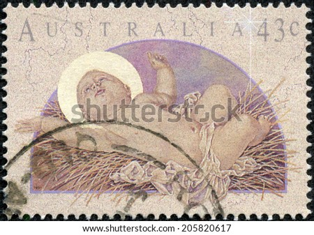 AUSTRALIA - CIRCA 1991: Postage stamp printed in Australia, Christmas Issue, shows Baby Jesus, circa 1991 - stock photo