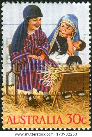 AUSTRALIA - CIRCA 1986: Postage stamp printed in Australia, Christmas Issue, shows Kindergarten nativity play: Holy Family, circa 1986 - stock photo