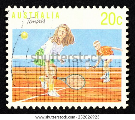 AUSTRALIA - CIRCA 1990: Postage stamp printed in Australia with image of a girl and a boy tennis player.  - stock photo