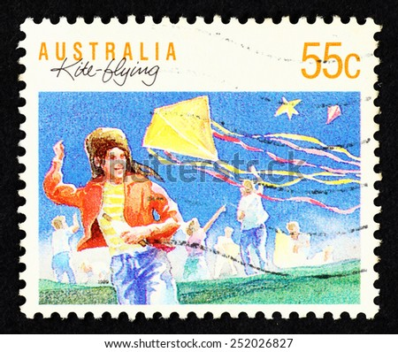 AUSTRALIA - CIRCA 1989: Postage stamp printed in Australia with image of a girl with a kite.  - stock photo