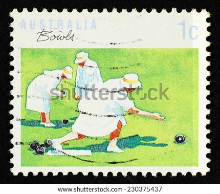 AUSTRALIA - CIRCA 1990: Postage stamp printed in Australia with image of lawn bowler sportswoman. - stock photo