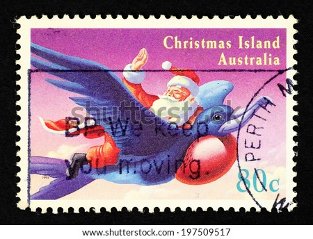 AUSTRALIA - CIRCA 1995: Postage stamp printed in Australia with image of Santa Claus flying on a blue bird.  - stock photo