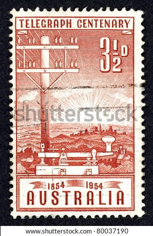 AUSTRALIA - CIRCA 1954: Stamp printed in Australia commemorating 100 years of telegraph service in Australia, circa 1954. - stock photo