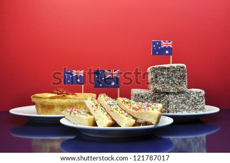 Australia Day January 26, - or Anzac Day - celebrate with traditional Aussie tucker food such as lamingtons, meat pies and tomato sauce, and yummy fairy bread. - stock photo