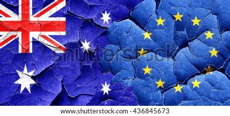 Australia flag with european union flag on a grunge cracked wall - stock photo