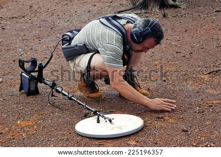 AUSTRALIA - MAY 13: gold miner in the Australian bush student mineralized soil reacted his metal detector may be on a gold nugget, may 13, 2007. - stock photo