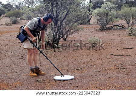 AUSTRALIA - MAY 13: Gold miner in the Australian outback prospecting area in the bush with his metal detector looking for gold nuggets, may 13, 2007. - stock photo